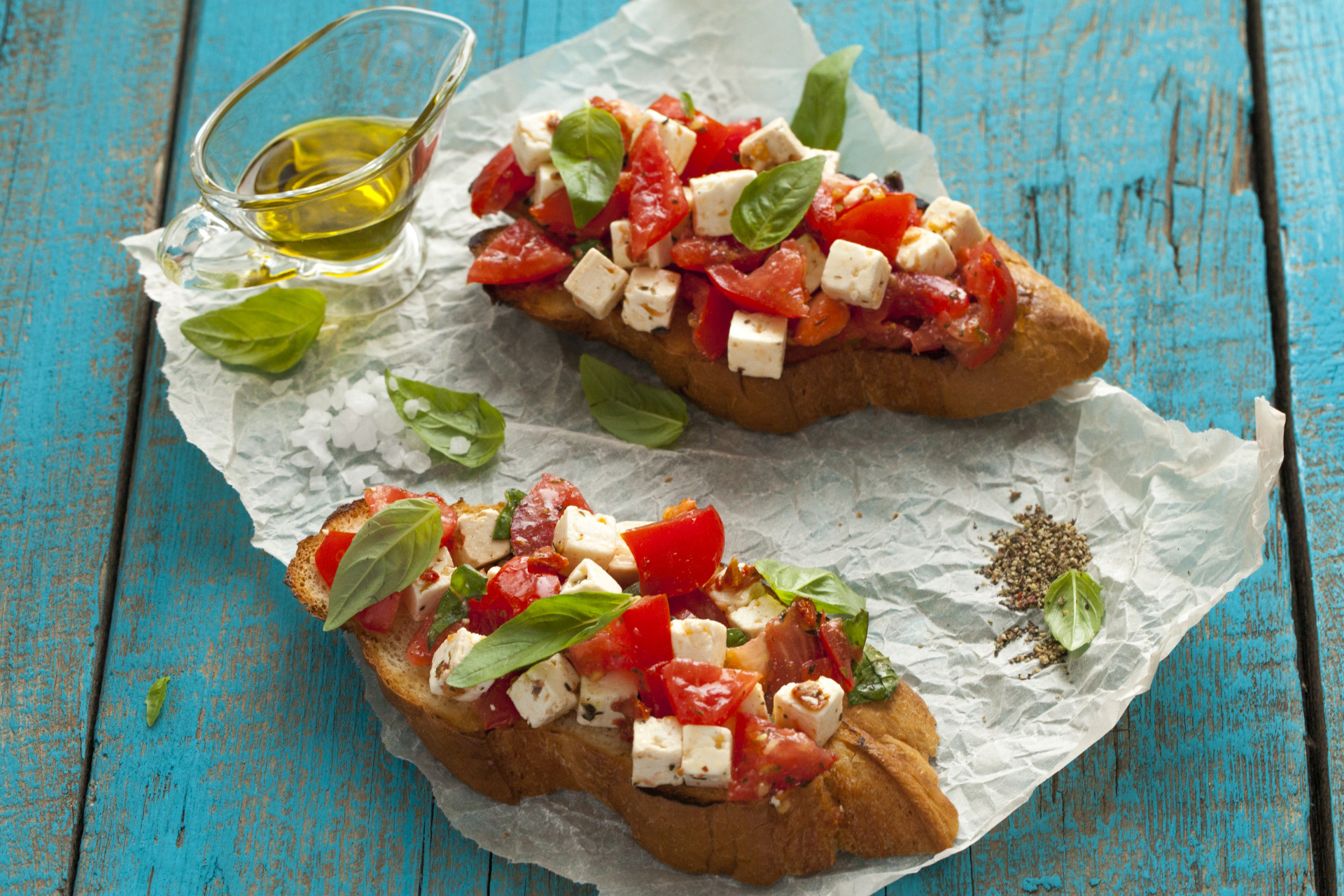 Sandwiches with tomatoes, feta cheese and basil