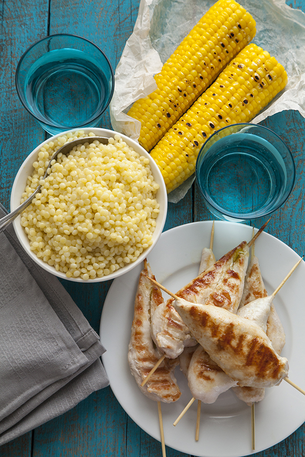 Grilled chicken with couscous and ear corn